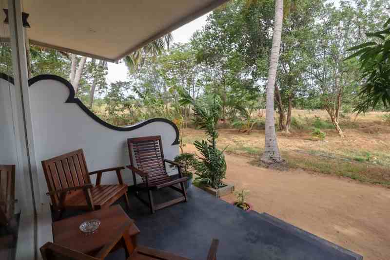 Kings Village Sigiriya Hotel Patio with seats | accommodation costs in Sri Lanka