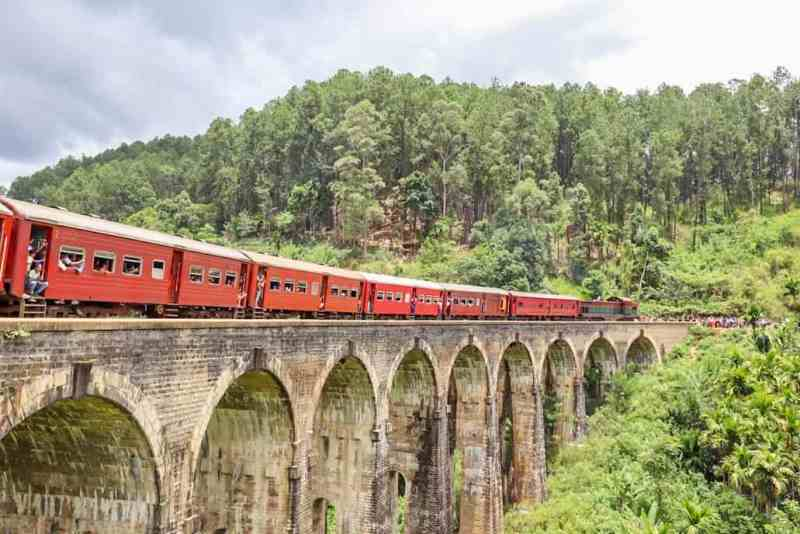 red train on Ella nine arch bridge