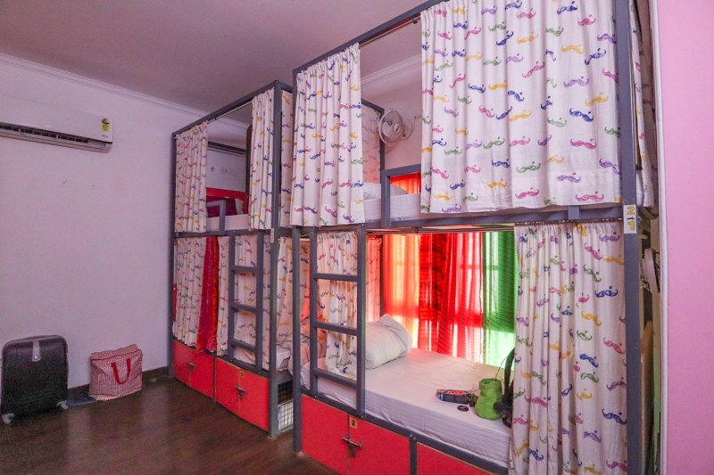 planning a trip to India, moustache hostel new delhi female dorm room bunkbeds with curtains