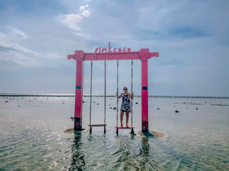 ellie quinn on pink coco resort sunset swing gili T