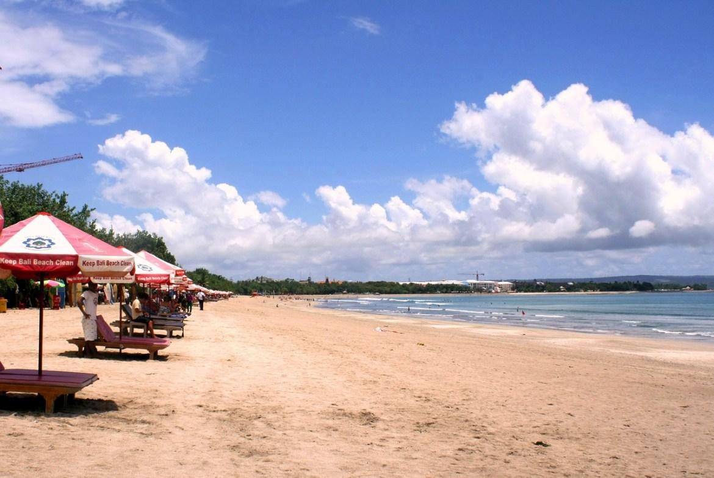 Bali Lombok itinerary, Kuta Beach Bali with beach chairs