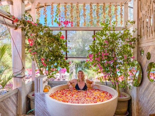 ellie quinn in flower bath in Gili T | things to do in Gili T