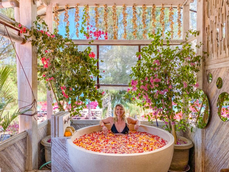 ellie quinn in flower bath in Gili T   things to do in Gili T