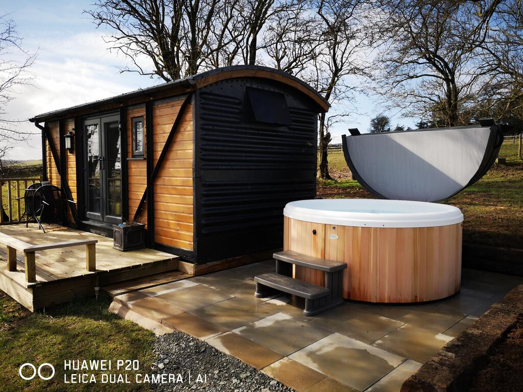 The Hare Hut outside with hot tub, glamping pod with hot tub wales