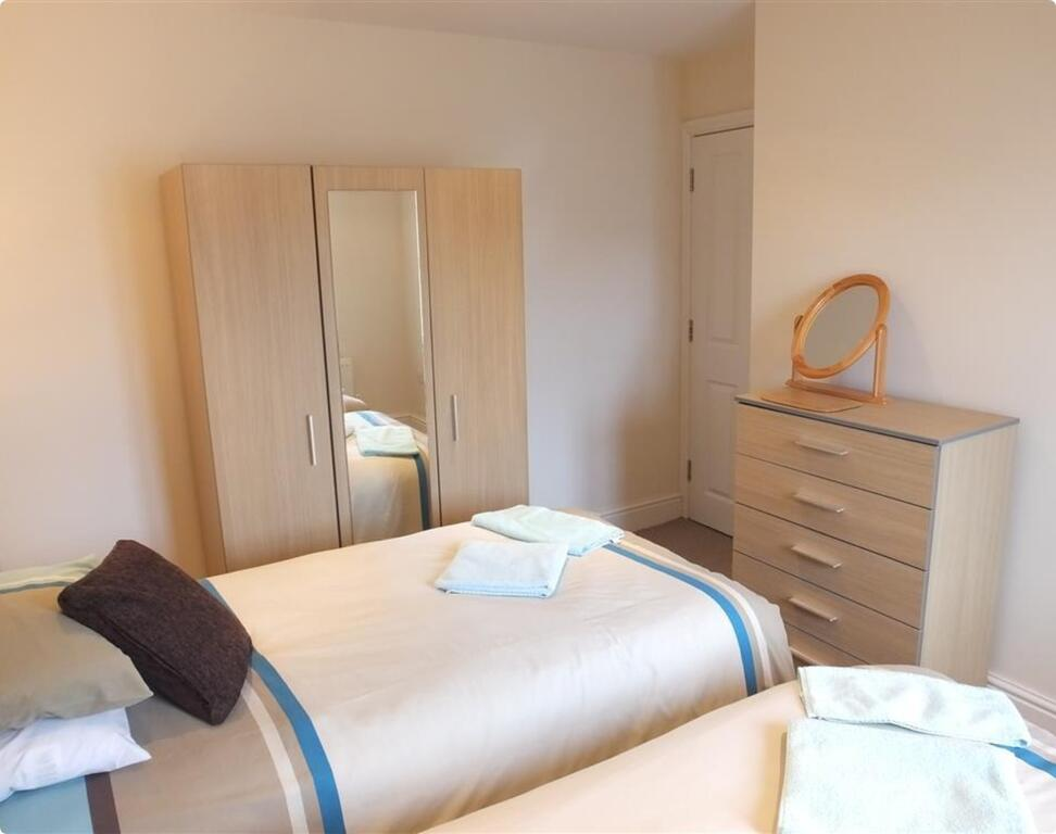 Colourful Tenby Cottage Twin Bedroom