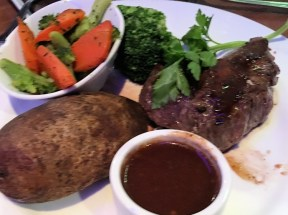 Flat Iron Steak with au jus, baked potato, and steamed broccoli and caarrots.