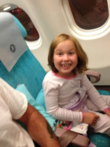 Catherine getting settled in on the plane