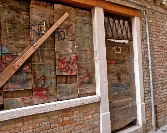 Derelict door and boarded window, San Barnaba