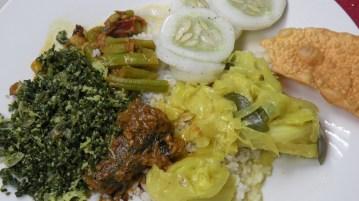 Fish curry with bonchi dry curry, gova sudu curry, gothukola sambole, pepinia salade and papadum
