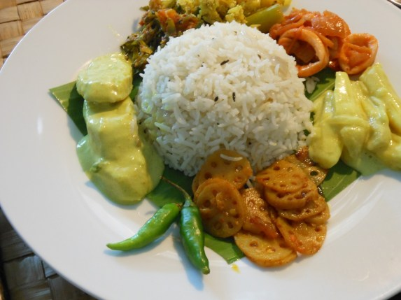 Cumin rice, with cuttle fish and fish sauce, ash plantain white curry, cabbage white curry, wing bean dry curry and lotus root tempered with tamarind