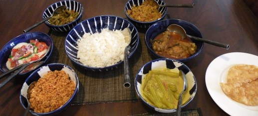 Lunch with chicken curry and murunga - and cabbage mallung, sautéed beans, cucumber salad and pol sambol.