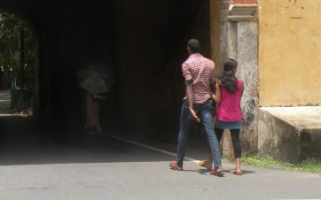 """… and what's with that hand? He's not motioning to himself """"come on, come on"""" to the girl, is he? Galle Fort, Sri Lanka"""