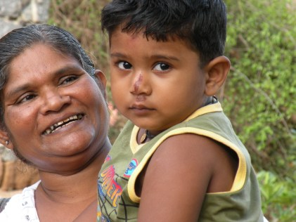 This solumn boy had been carried up the umpteen stairs to the temple at Mihintale by his Grandfather. Now Achchi had taken over.
