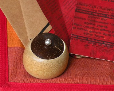 Polished coconut shell lid made stylish with a sterling silver knob