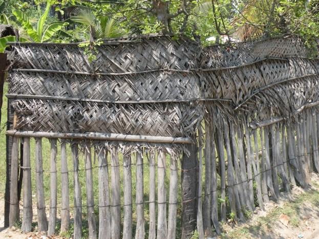 Kadjan modesty screens atop palmyrah posts