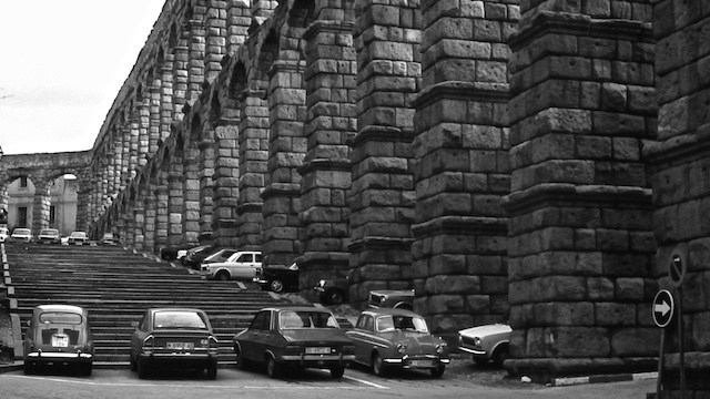 The aqueduct becomes a parking lot, Segovia. Hopefully this is a thing of the past, but we all know how parking lots are taking over our precious spaces!