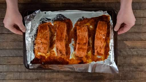 Looking for salmon Asian recipes? Check this out! This Asian Salmon Recipe is salmon topped with a glaze filled with the bold flavors of hoisin sauce, garlic, and siracha.