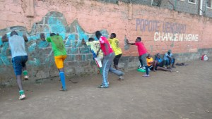 Coach Yari leading Baba Dogo United FC through some acceleration drills on the wall. Shirts are dirty because I make them do some ground exercises for preparation phases