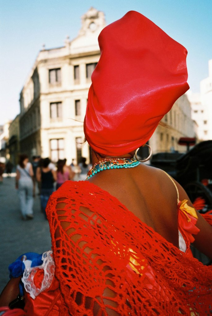 [cml_media_alt id='741']A red lady in Havana Photo: Polys Pulcherios[/cml_media_alt]