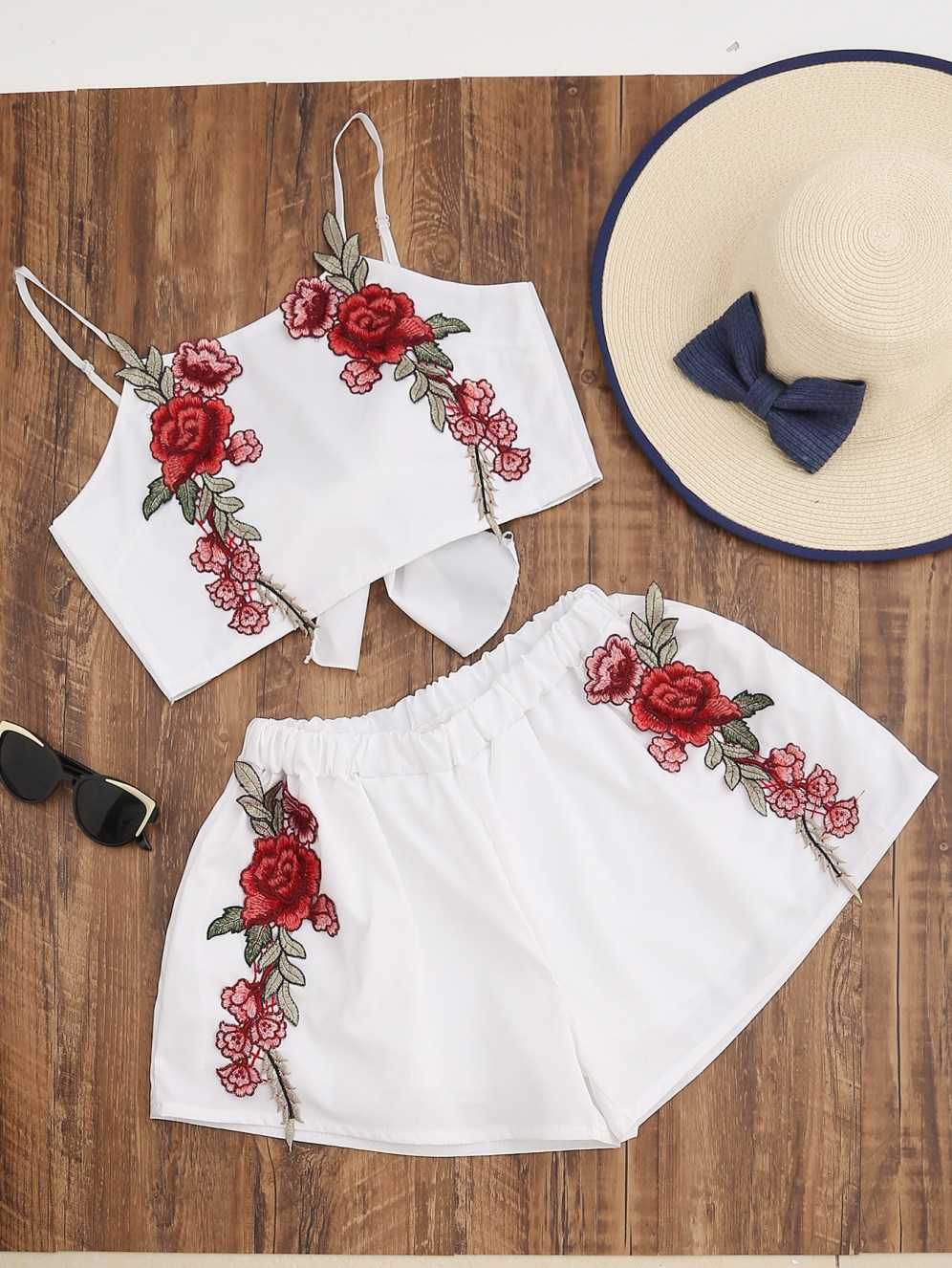 http://us.shein.com/Flower-Applique-Tie-Back-Cami-Top-With-Shorts-p-350502-cat-1780.html