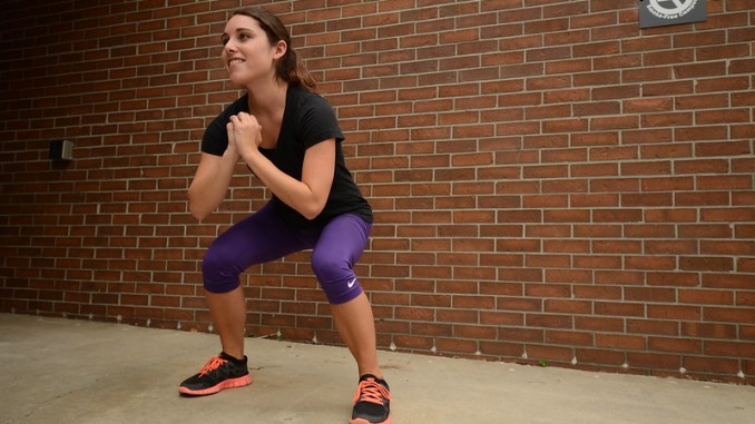 a woman doing squats