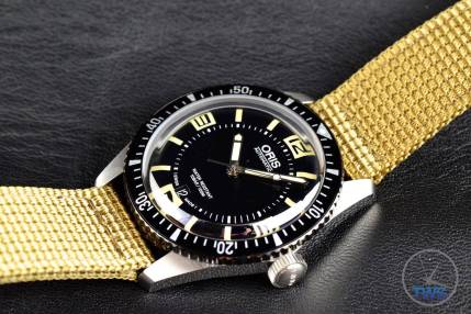 Oris watch laying diagonally with crown pointing out - Oris Divers Sixty-Five: Hands-On Review [01 733 7707 4064-07 5 20 22]