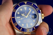 Rolex held between finger and thumb - Submariner Date: Hands-On Review [116613LB]