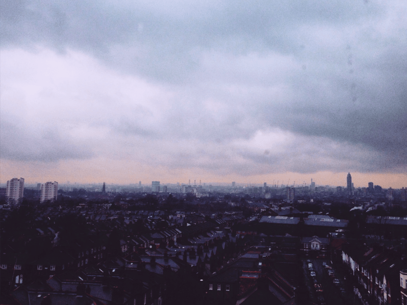 london skyline rain grey sky clouds