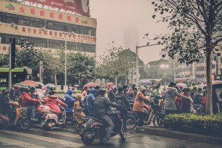 Thousands of electric motorbikes and scooters line the streets and sidewalks in Nanning, China. February 2014.
