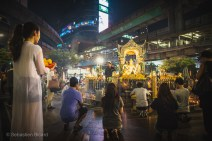 Hindu devotees come to worship day and night at Erawan Shrine. Bangkok, Thailand, April 2014.