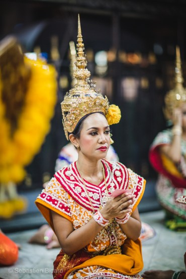 A Thai dancer in traditional dress performs at the Erawan Shrine. Bangkok, Thailand, April 2014.