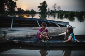 Young girls gather fish for dinner in the Mekong. Don Det, Laos, March 2014.