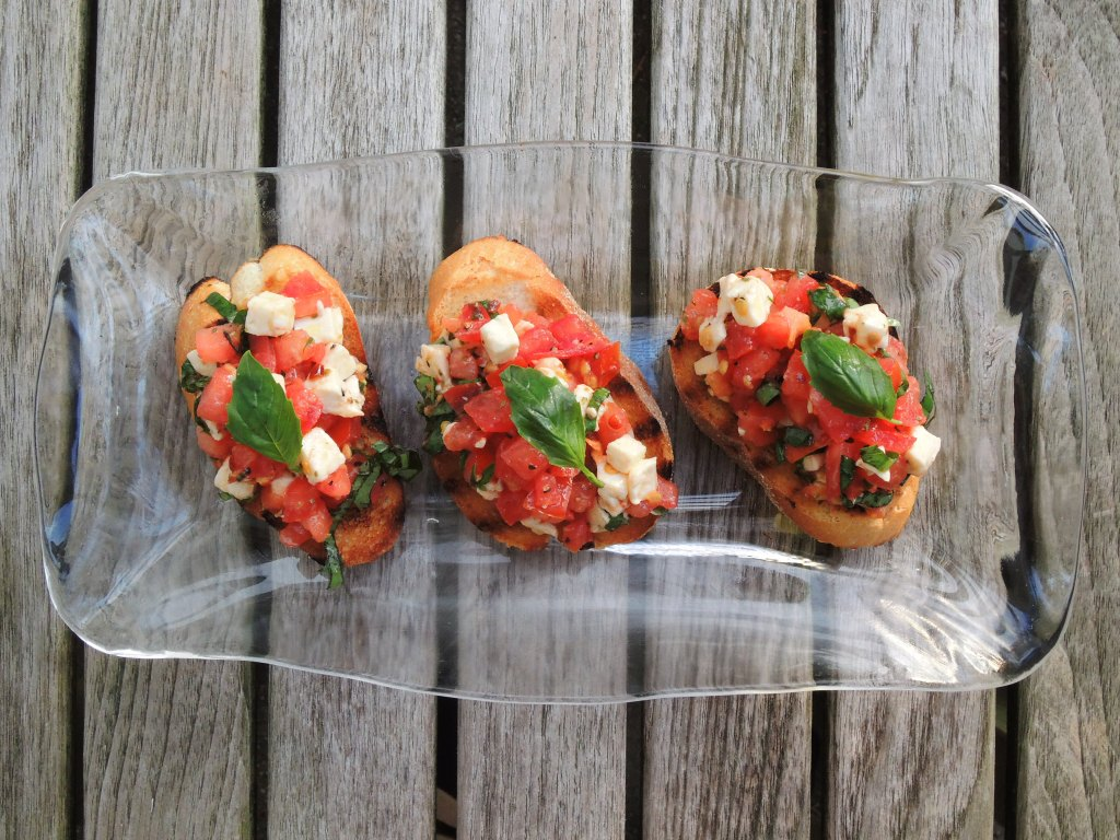 Appetizers, toasts, basil, mozzarella and tomato crostini 1