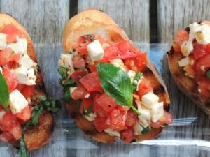 Appetizers, toasts, basil, mozzarella and tomato crostini 2