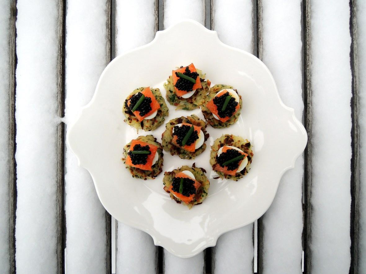 Appetizers, eggs, quail eggs, potato latkes with smoked salmon, quail eggs and sevruga caviar 1