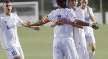 Juan Luna, Erik Peachey, and Dominic Powers celebrate