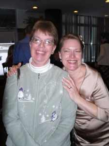 WeCo President Lynn Wehrman, smiling and posing with her sister, Amy, at her wedding.