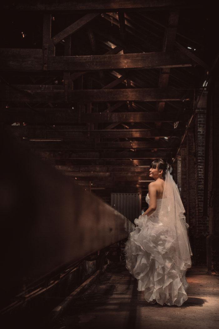 Ruffle bridal gown. Photography by Kennfoo Weddings