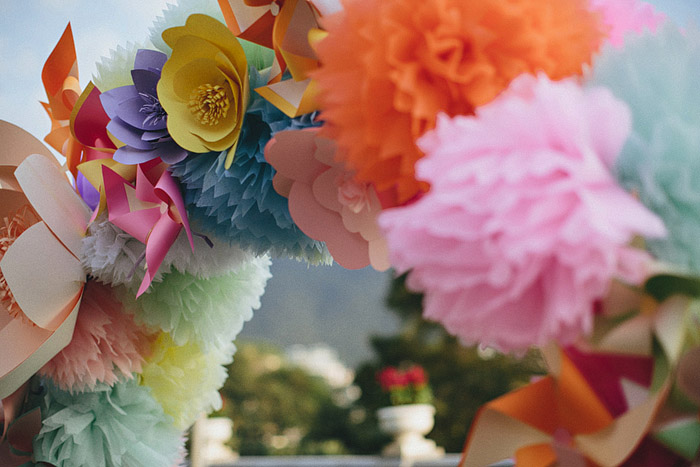 www.theweddingnotebook.com.Photography by History Studio. Colourful wedding arch