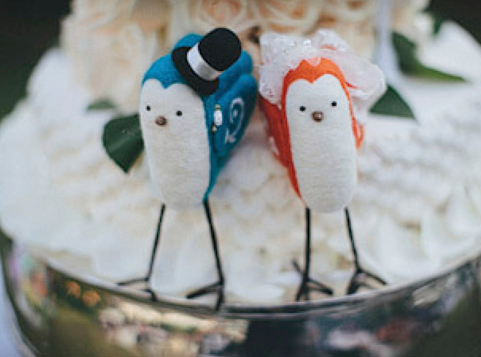 www.theweddingnotebook.com.Photography by History Studio. Love birds wedding cake topper