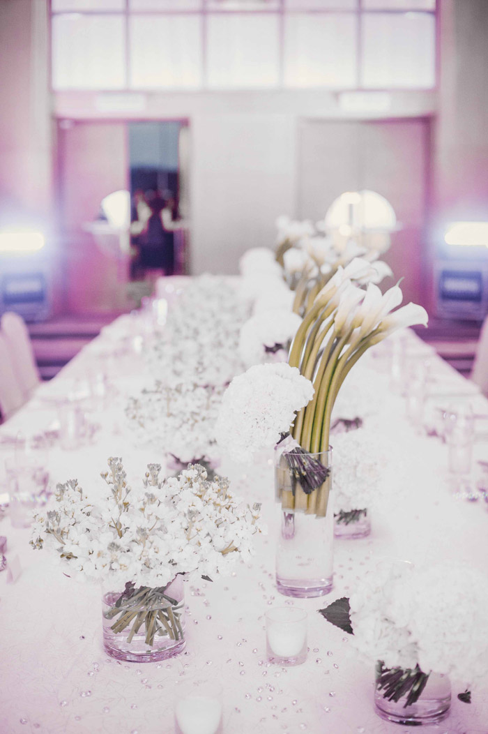 White on white wedding table centrepiece. Photography by Creative Clicks. www.theweddingnotebook.com