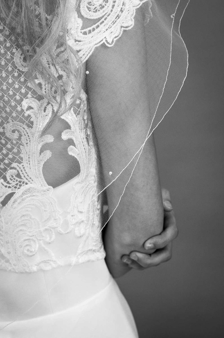Abigail - two tier elbow length wedding veil with scattered crystas and pearls closeup bw