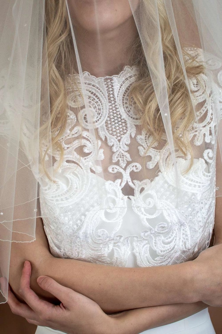Abigail - two tier elbow length wedding veil with scattered crystas and pearls closeup of blusher