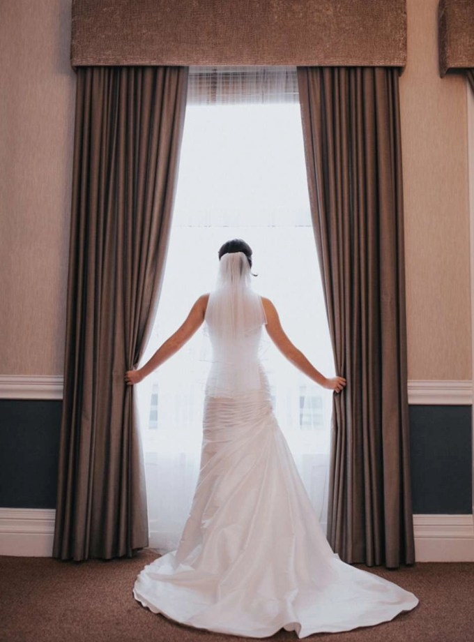 Amber – two tier waist length veil with a ribbon edge