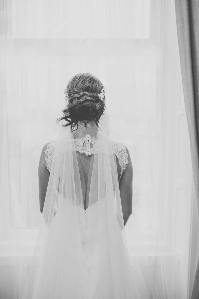 Close up shot of bride wearing a 1920s inspired drape veil in silk effect tulle