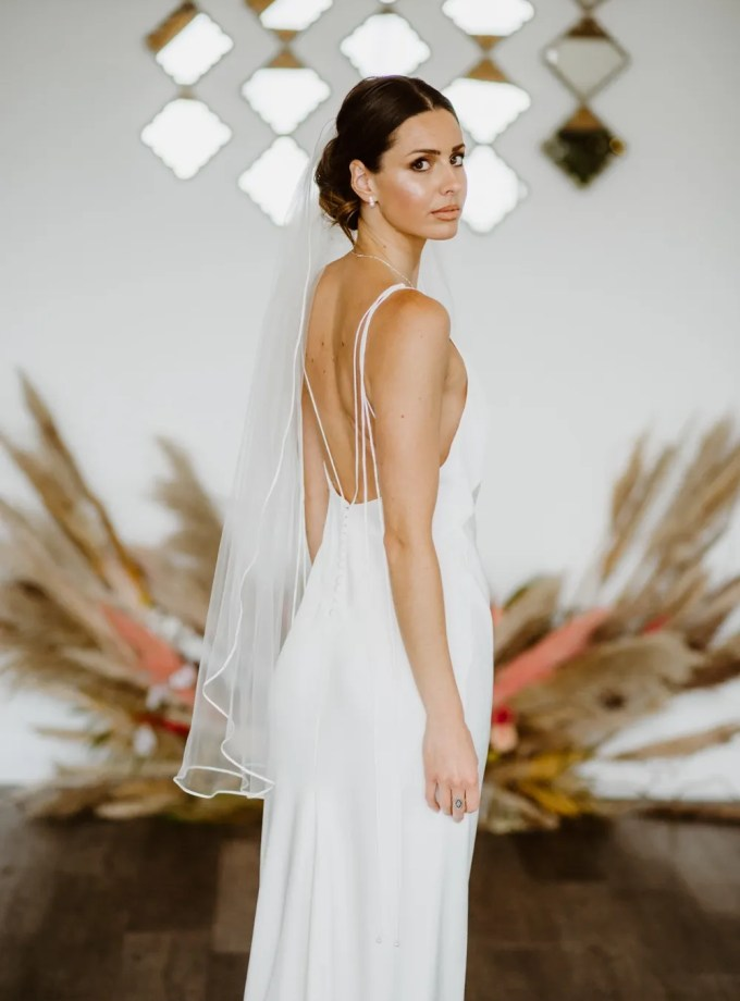 Faith – one layer fingertip length veil with a satin edge
