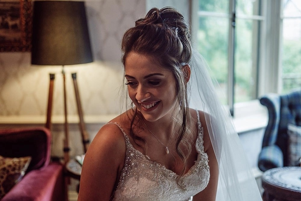Happy bride in curly edge veil