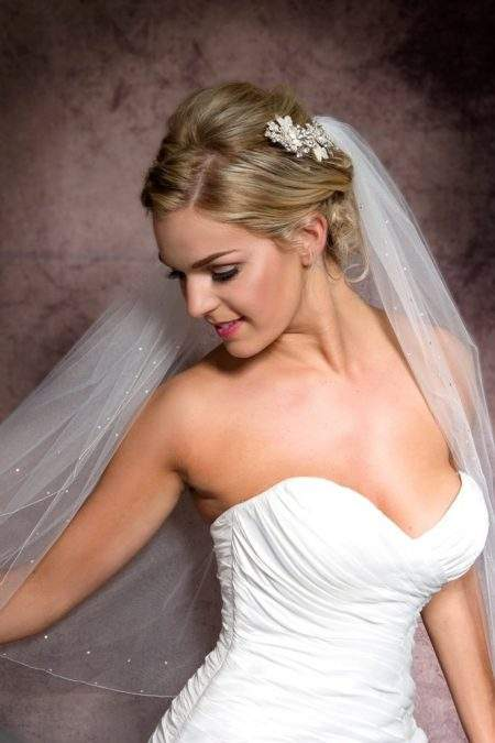 Close up of happy bride wearing a veil with a simple edge