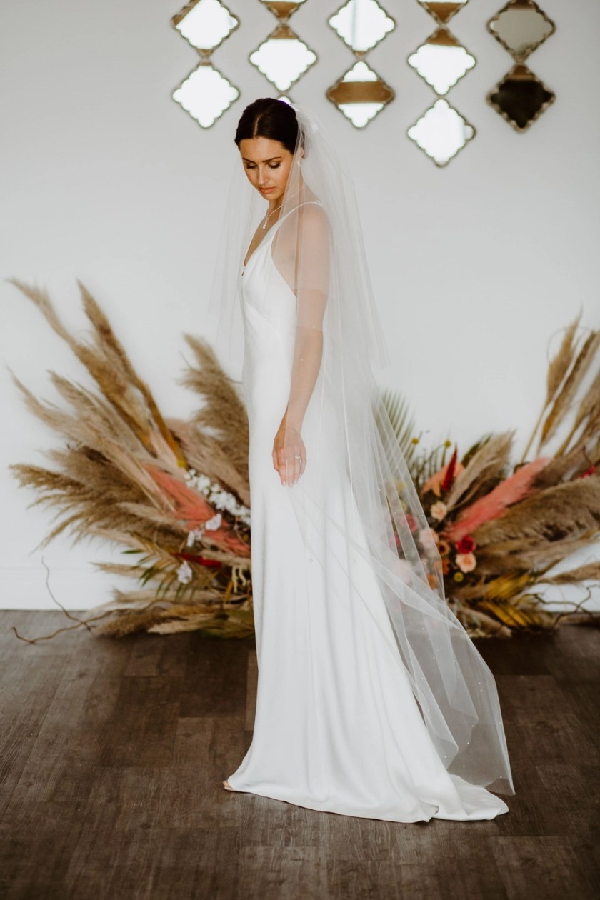 Isla – two layer floor length veil with a cut edge & scattered pearls walking