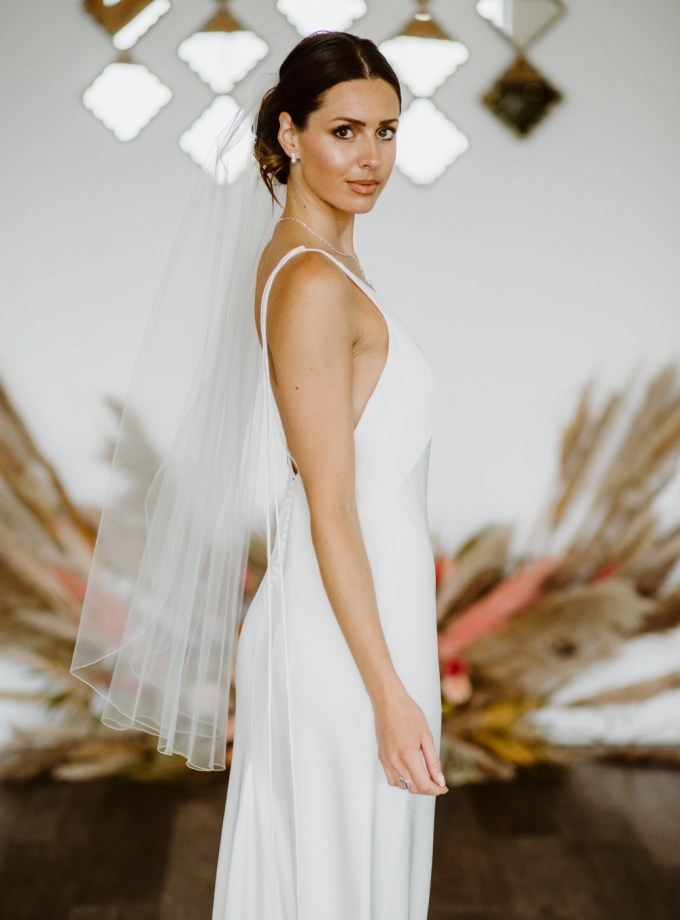 Lauren – single layer fingertip length veil with a pencil edge